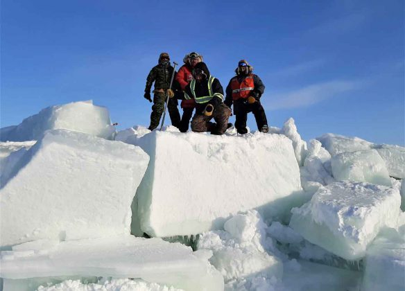 Canadian Rangers climb huge blocks of ice on the shore of James Bay. credit Lieutenant-Colonel Shane McArthur, Canadian Rangers