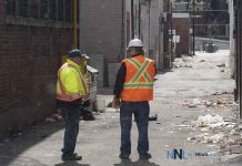Thunder Bay Roads Crew surveying lane