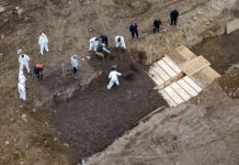 ARCHIVE PHOTO: Drone pictures show bodies being buried on New York's Hart Island where the department of corrections is dealing with more burials overall, amid the coronavirus disease (COVID-19) outbreak in New York City, U.S., April 9, 2020. REUTERS/Lucas Jackson