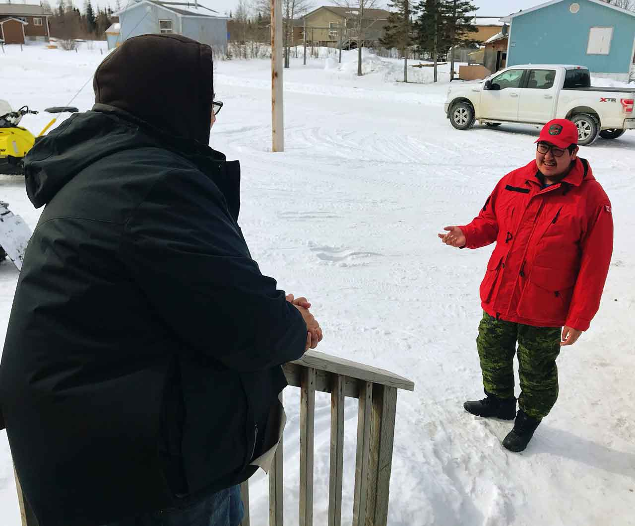 Ranger Joseph Hunter conducts a wellness check with a resident of Peawanuck. Photo credit: Master Corporal Jason Hunter, Canadian Rangers