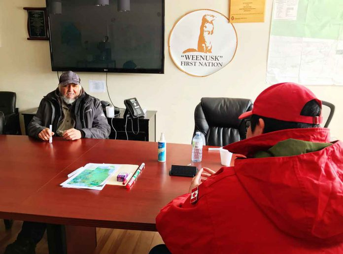 Peawanuck Chief Abraham Hunder talks with Ranger Joseph Hunter about the Covid-19 situation. photo credit: Master Corporal Jason Hunter, Canadian Rangers
