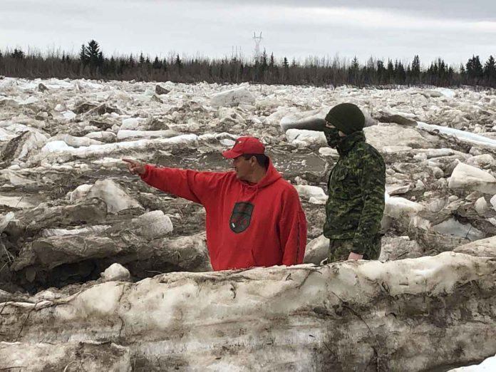 Master Corporal Joe Lazarus, left, shows Corporal Randy Jones, a visiting soldier what to look for as the Albany River breaks up.