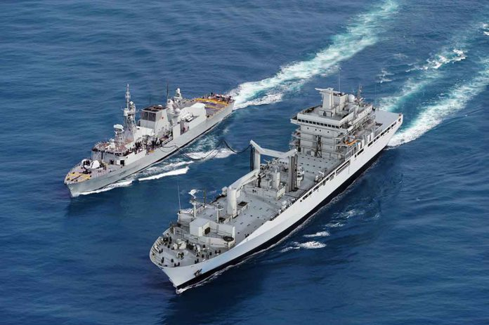 Artist rendering of the future Protecteur-class ship replenishing a Canadian vessel at sea