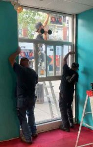 New Touchless Window at The Hub on Victoria Avenue East being installed
