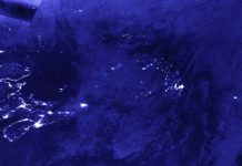 NASA-NOAA's Suomi NPP satellite provided a nighttime view of Post-Tropical Cyclone Teddy over Newfoundland, Canada at 1:40 a.m. EDT (0540 UTC) on Sept. 24. The nighttime lights of Newfoundland can be seen somewhat through Teddy's clouds, and the nighttime lights of Nova Scotia were visible, revealing the Teddy had moved past the province. CREDIT: NASA Worldview, Earth Observing System Data and Information System (EOSDIS)