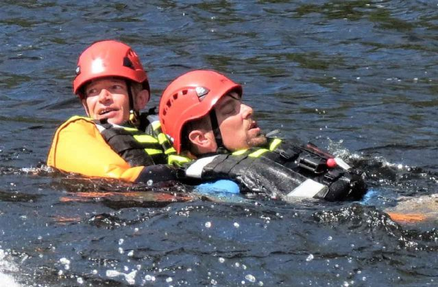 """Warrant Officer Kevin Meikle,left, drags a """"victim"""" to shore during white water rescue training. credit Sergeant Peter Moon"""