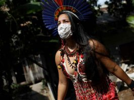 Samela Satere-Mawe, a 24-year-old biology student and Indigenous activist walks near her home, which is also the headquarters of the Satere Mawe WomenÕs Association in the Compensa neighborhood in Manaus, Amazonas state, Brazil, October 2, 2020. REUTERS/Bruno Kelly