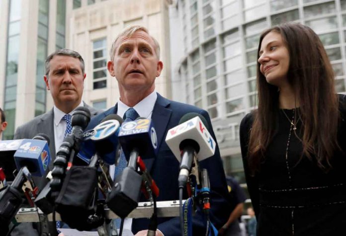 ARCHIVE PHOTO: Richard P. Donoghue, United States Attorney for the Eastern District of New York, speaks to the media after the guilty verdicts in the sex trafficking and racketeering case against Nxivm cult founder Keith Raniere outside the Brooklyn Federal Courthouse in New York, U.S., June 19, 2019. REUTERS/Shannon Stapleton