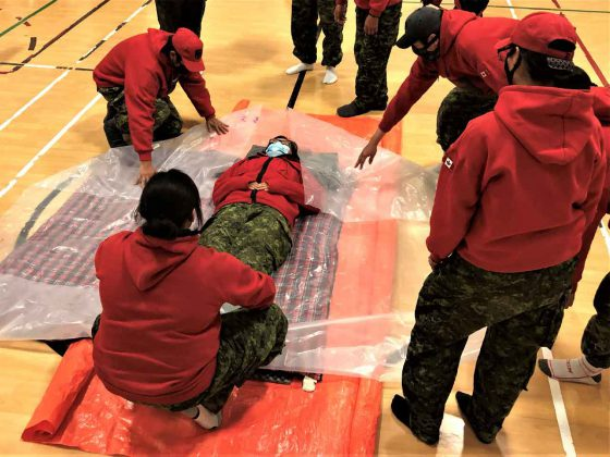 Rangers prepare to warm up a victim of cold water immersion. credit Warrant Officer Carl Wolfe