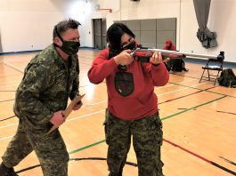 Master Warrant Officer Fergus O'Connor instructs Master Corporal Lilly Kejick on the correct use of the Ranger .308 rifle. Credit Warrant Officer Carl Wolfe