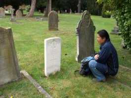 John Chookomolin's final resting place is in St Jude's Cemetery in Englefield Green, UK, a small community on the outskirts of the city of London, England. Here we see Xavier Kataquapit at the grave of his great grandfather during a visit to England.