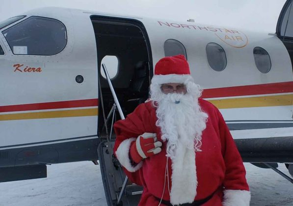 "Santa arrived in Pikangikum on a Special North Star Air flight onboard ""Blackfly 704"""