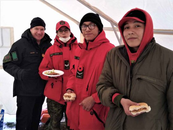 Taking a quick snack between Ranger duties are, from left, Petty Officer Second Class Kevin McCue, an instructor, Corporal Sandi Moose, Ranger Clayton Peters, and Corporal Eli Owens. credit: Canadian Rangers