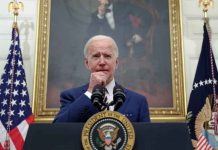 U.S. President Joe Biden speaks about his administration's plans to respond to the economic crisis, in the State Dining Room at the White House in Washington, U.S., January 22, 2021. REUTERS/Jonathan Ernst