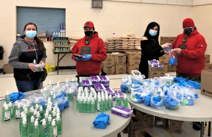 Preparing personal protective equipment packages for the residents of Ginoogaming are, from left, local worker Tracy Dore, Corporal Marianne Echum, local worker Shelley Franceschini, and Ranger Jody Grenier. Credit Warrant Officer Carl Wolfe