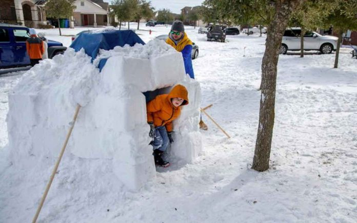 Freak cold in Texas has scientists discussing whether climate change is to blame by Reuters Wednesday, 17 February 2021 20:11 GMT Brett Archibad helps his son build an Igloo as his son Avett Archibad ,8, peeks out of the Igloo in their front yard of their home in the BlackHawk neighborhood in Pflugerville, Texas, U.S. February 16, 2021. Picture taken February 16, 2021. Ricardo B. Brazziell/American-Statesman/USA Today Network via REUTERS. NO RESALES. NO ARCHIVES. MANDATORY CREDIT