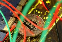 FILE PHOTO: Representation of the bitcoin virtual currency standing on the PC motherboard is seen in this illustration picture, February 3, 2018. REUTERS/Dado Ruvic/Illustration/File Photo