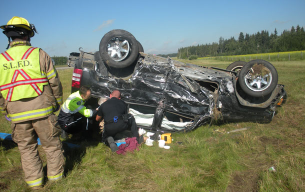 The 80 year old driver of this Jeep Liberty survived the crash - RCMP Photo