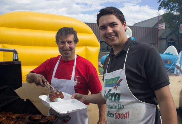 St. Anthony Holy Name Society - Barbecue - Here Peter Pullia serves up some fall of the bone ribs.