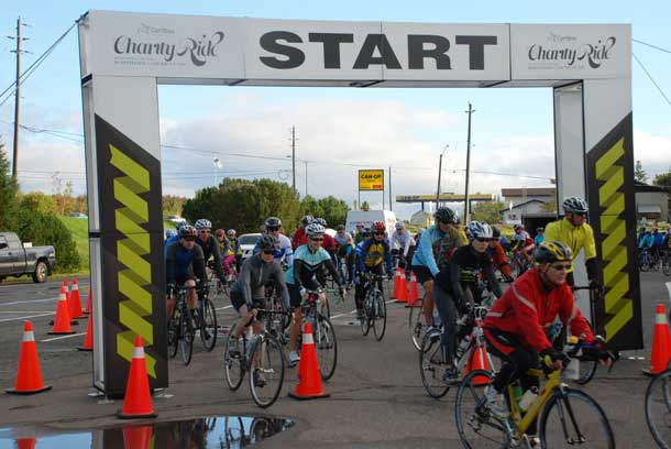 Riders depart on the 100 km Caribou Charity Ride on a chilly, but beautiful fall morning.