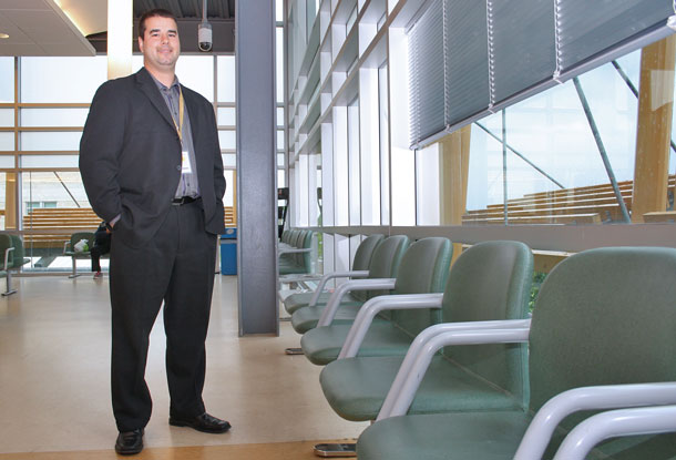Adam Vinet, Manager, Emergency/Trauma Services. Part of patient care includes keeping the waiting area clean and comfortable. A Family CARE Grant helped replace worn and cracking chairs.