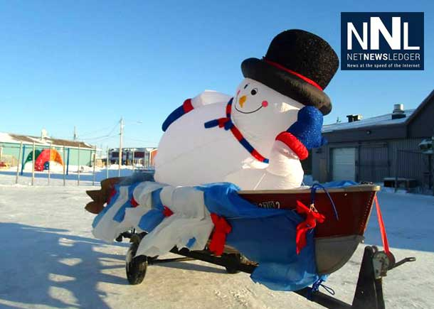 Attawapiskat Christmas Parade. Frosty the Snowman reclines in the perfect conditions for a snowman, Photo by Rosiewoman Cree.