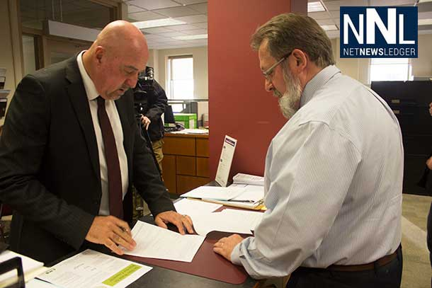 Thunder Bay Mayor Keith Hobbs filing his papers with City Clerk John Hannam.