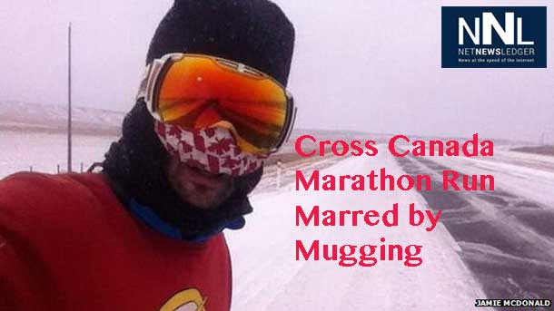 Jamie Mcdonald's cross country marathon has been marred by a mugging in Banff Alberta