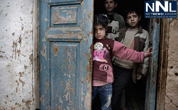 Syrian children shelter in the doorway of a house, amid gunfire and shelling, in a city affected by the conflict. Photo: UNICEF/NYHQ2012-0218/Alessio Romenzi