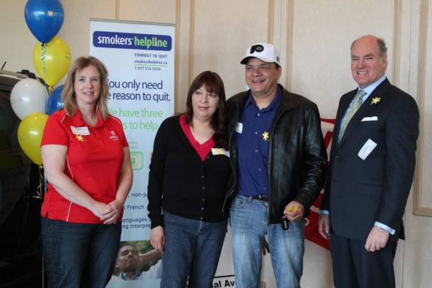 Canadian Cancer Society's Driven to Quit Challenge 2014 Grand Prize winner Ralph Baxter of Thunder Bay stands with his support buddy Yvonne Ralph (both centre) along with Kari Jefford, President, Unifor, Local 229 (left), and Don Paterson, past-Chair, Canadian Cancer Society, Ontario Division.