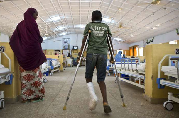 This 14-year-old boy was shot when gunmen attacked his school in Nigeria, killing three of his friends. His parents will take him away from the area. UN Photo/Isaac Billy