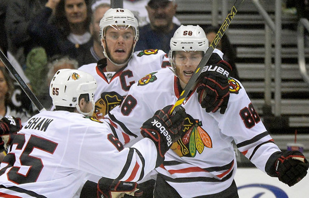The Chicago Blackhawks celebrate after a win in Game Six