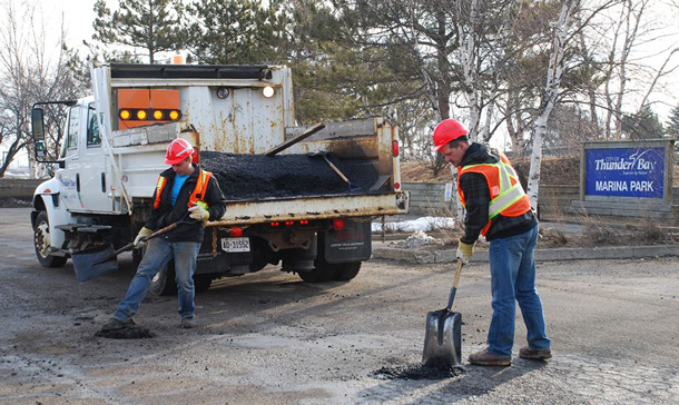 Fixing the potholes at Marina Park. The parking lot has been like a minefield for vehicles for the past year.