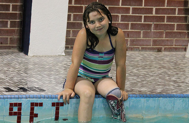 Addisyn in the pool with her new swim leg.