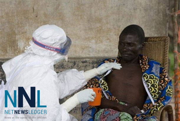 A nurse comforts a patient who has been diagnosed to have the Ebola virus. Photo: WHO/Chris Black