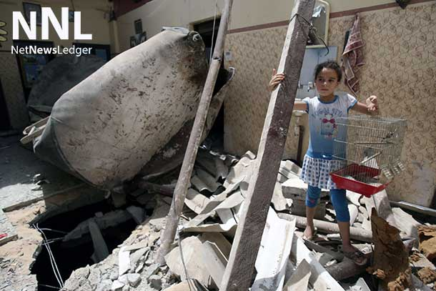 A Palestinian girl stands on the ruins of her home after it was destroyed in an airstrike in a refugee camp in the city of Rafah in the southern Gaza Strip (12 July 2014). ©UNICEF/NYHQ2014-0911/El Baba