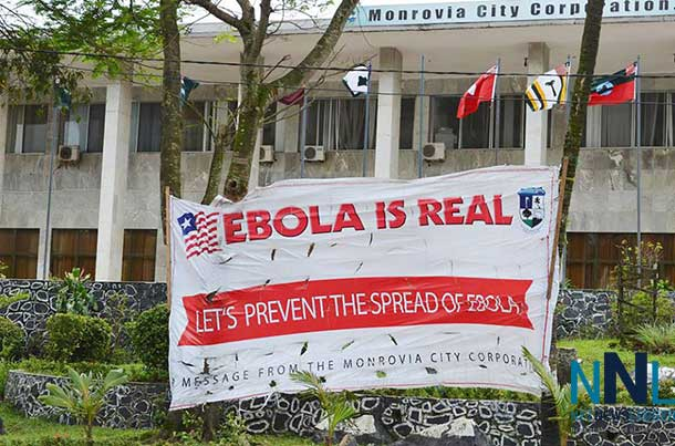 A sign outside the Monrovia City Corporation in Liberia aims at preventing the spread of Ebola. Photo: UNMIL