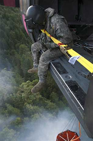 A UH-60 Black Hawk helicopter crew from the California Army National Guard drops 660 gallons of water on a Northern California fire, Aug. 4, 2014. U.S. Army photo by Sgt. 1st Class Benjamin Cossel