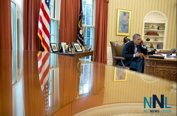 President Barack Obama talks on the phone with British Prime Minister David Cameron in the Oval Office, Saturday, Aug. 9, 2014. (Official White House Photo by Pete Souza)