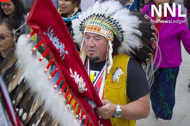 Assembly of Manitoba Grand Chief Derek Nepinak walking in the Full Moon Memory Walk