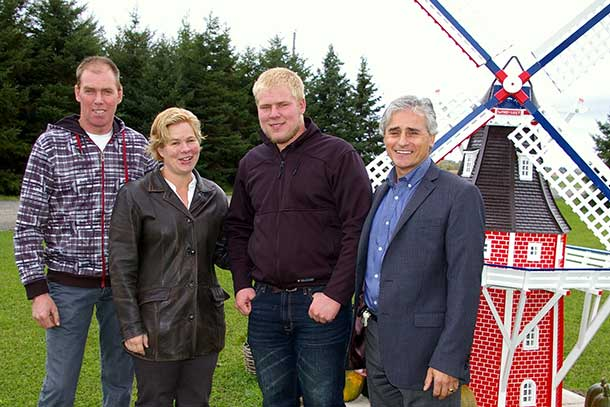 Minister Bill Mauro with Gert & Peggy Brekveld, owners of Woodstar Farm, and their son Andrew.