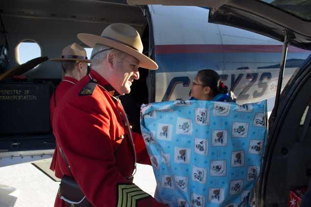 (l-r) RCMP S/Sgt. Normand Roy, Hailey Sakenee, Kurtis Meekis, and Cynthia Meekis in Landsdowne House