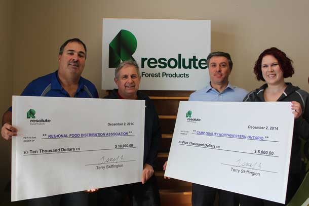 Resolute Forest Products JHSC Co-Chairs Alex Cryderman (left) and Tony Ruberto (second from right) present their contributions to Volker Kromm, Executive Director of the RFDA (second from left), and Ashleigh Quarrell Director of Camp Quality.