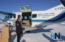 Unloading a plane full of bottled water in Ogoki Post / Marten Falls First Nation