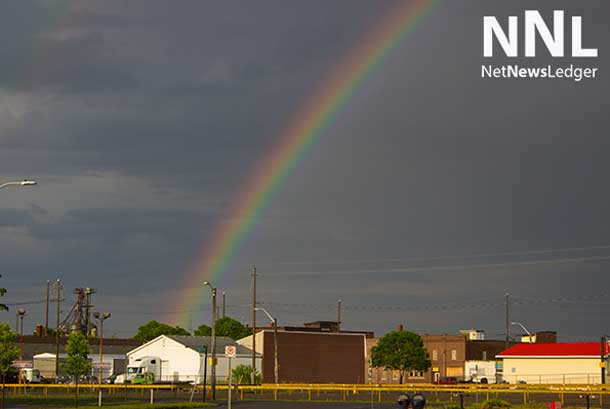 First storm generated loud thunder, and knocked down some trees and branches... afterward a rainbow in the South Side
