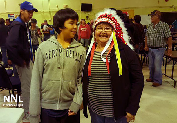Ginoogaming First Nation Chief Echum with a young supporter