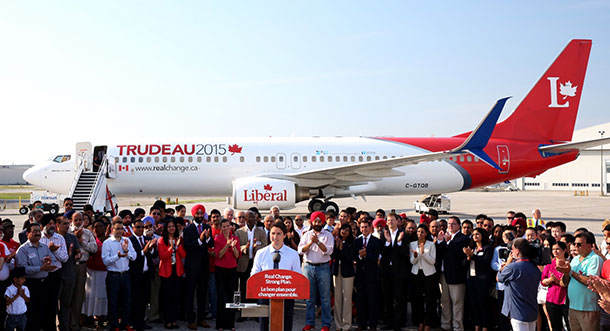 Justin Trudeau stands in front of the new Liberal campaign plane