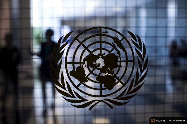 A United Nations logo is seen on a glass door in the Assembly Building at the United Nations headquarters in New York City September 18, 2015. As leaders from almost 200 nations gather for the annual general assembly at the United Nations, the world body created 70 years ago, Reuters photographer Mike Segar documented quieter moments at the famed 18-acre headquarters on Manhattan's East Side. The U.N., established as the successor to the failed League of Nations after World War Two to prevent a similar conflict from occurring again, attracts more than a million visitors every year to its iconic New York site. The marathon of speeches and meetings this year will address issues from the migrant crisis in Europe to climate change and the fight against terrorism. REUTERS/Mike SegarPICTURE 13 OF 30 FOR WIDER IMAGE STORY