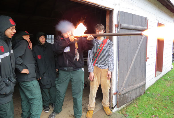 Junior Canadian Rangers learn to fire muskets at Fort William Historical Park