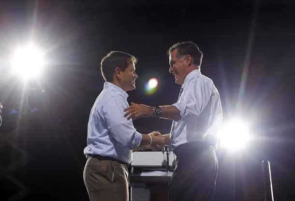 File photo of Mitt Romney (R) shaking hands with Marco Rubio (L) at a campaign rally in Coral Gables, Florida October 31, 2012. REUTERS/Brian Snyder